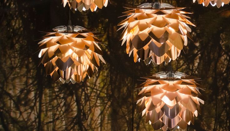 Combining natural elements with modern innovation, the Silvia typifies the Scandinavian approach to design. Inspired by the iconic mid-century lighting of Danish designer Poul Henningsen, this copper pendant has a delicate, pine cone silhouette and is comprised of a series of metallic scales that create a stunning yet warm display of reflected light.