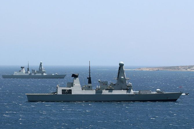 Sister ships briefly rendezvous in the med.Type 45 destroyers HMS Defender (foreground) conducts a handover with HMS Diamond (rear) in the coastal bay of Akrotiri in Cyprus.