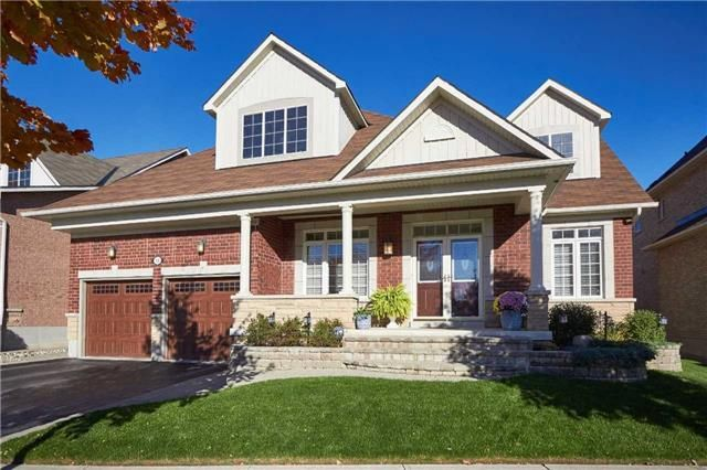 Stunning Brick/Stone Bungalow With A Lovely Backyard Perfect For Entertaining