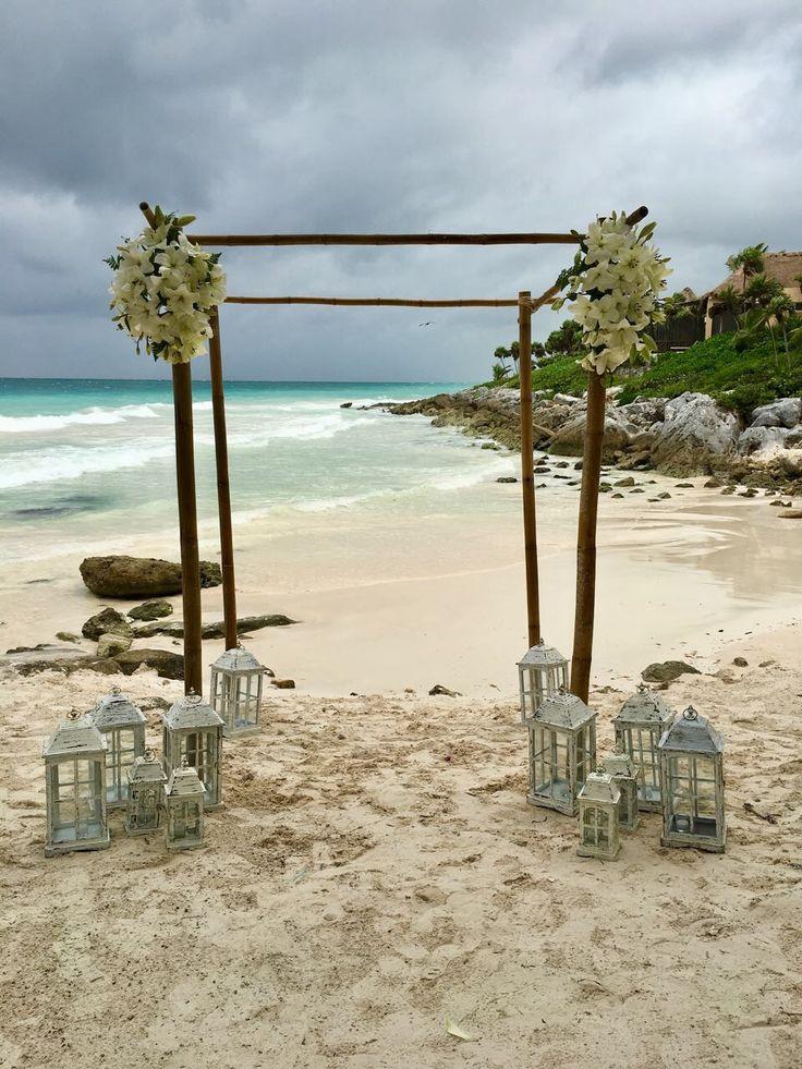 CBG239 wedding Riviera Maya  and white lilies and lanterns for ceremony/ ceremonia con arco con flores blancas linternas y telas