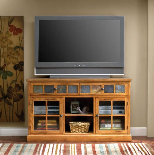 Natural slate tiles are inlaid along the front of this rustic television console for distinctive appeal. Two drawers. The two doors below have beehive glass panes, with open shelving in the middle for consoles or DVDs. At 60 inches this piece is ideal for flat screen televisions. Add the sofa mate, with a natural slate inlaid top and the same rustic oak finish, and you have a stunning set that works well in a variety of spaces.
