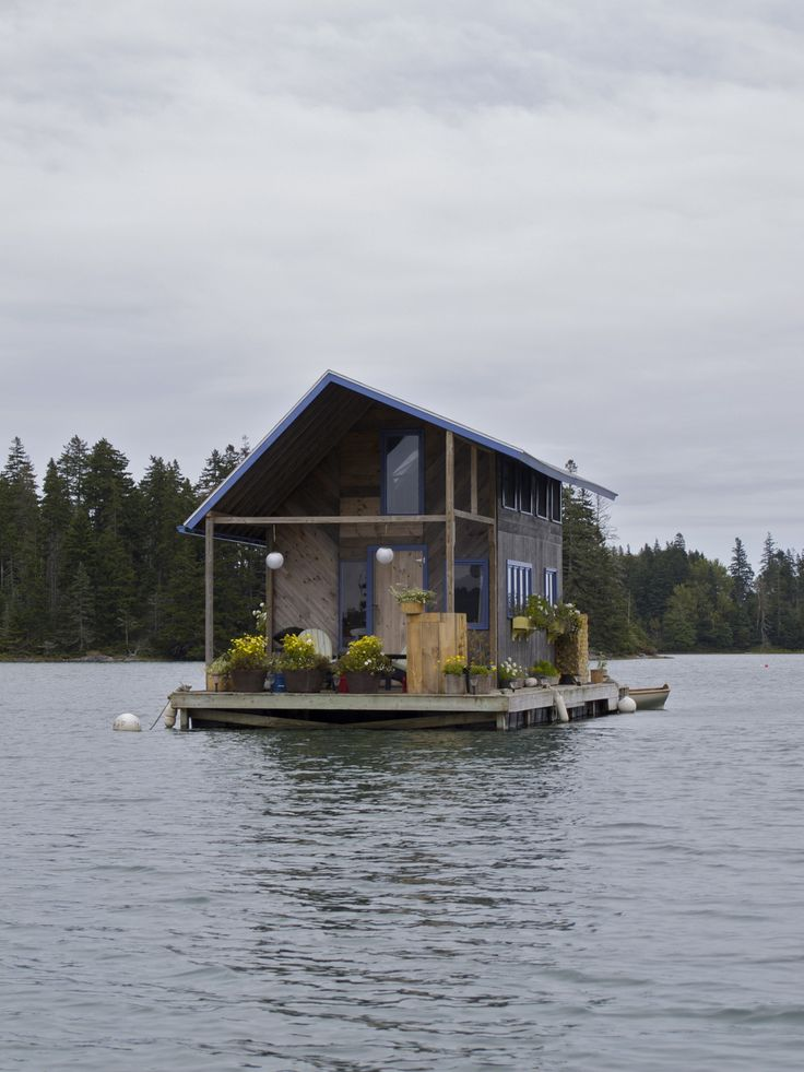 Hand-built floating cabin in Perry Creek, on the island of Vinalhaven, Maine.