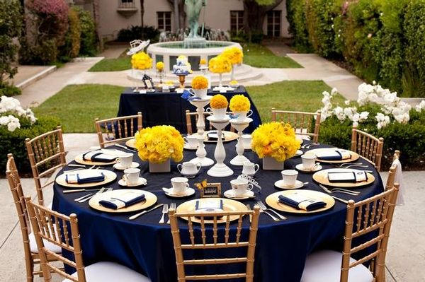 Dark blues, Pops of Yellow and a vibrant green surrounding.  Love the dark blue tablecloths