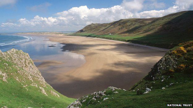 Rhossili Bay, Gower, Wales - Rhossili beach in Gower has been named one of the top 10 beaches in the world in 2014, for the second year in a row, and the best beach in the UK in a survey by travel website TripAdvisor.