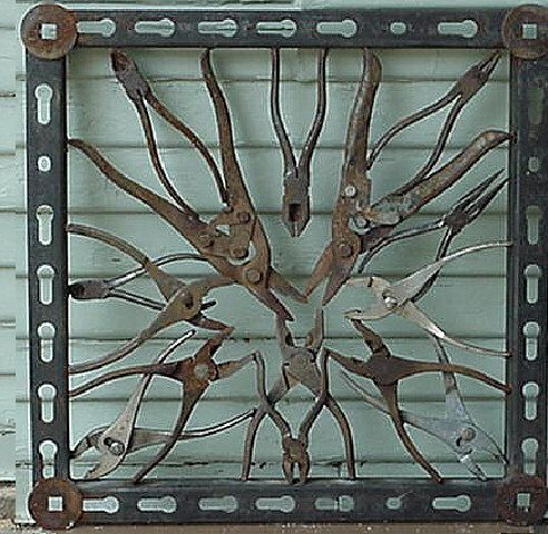 from etsy -- Decorative iron panel, tool / plyer design.   LOVE THIS!