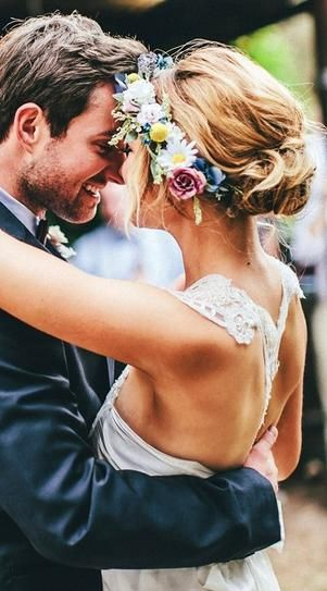 Bun Ideas for Brides | StyleCaster: The loose tendrils that escape just around her face give this look an effortless feel.