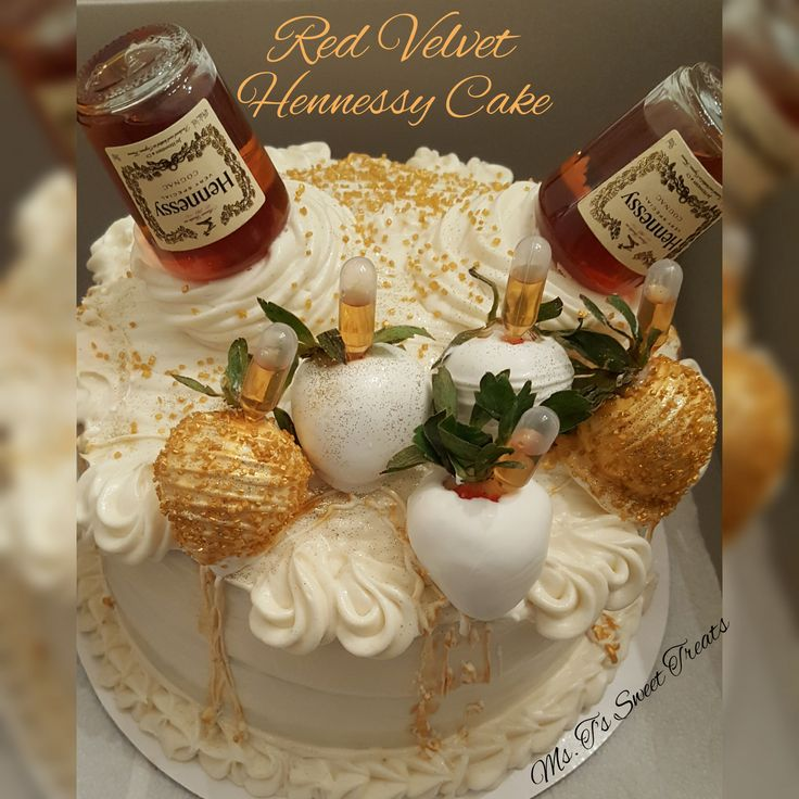 This is a Red Velvet Hennessy  flavored cake, topped with white chocolate covered strawberries,  infused  with Hennessy