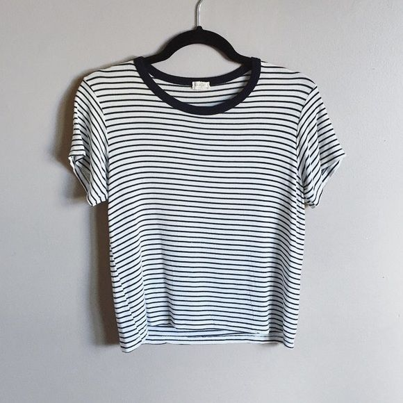 Brandy Melville striped tee Cute Brandy Melville striped T-shirt. Extremely soft and in great used condition. John galt from Brandy. White with dark blue stripes. It's OS but would fit a small of x-small. ❌no trades. Brandy Melville Tops Tees - Short Sleeve