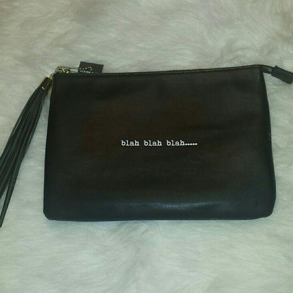 Blah Blah Blah.... Cute bag with tassel!  Could be used for multiple things.... Cosmetic bag, Handbag, etc.... cute and stylish.  *Bag measures approx. 10 in (w) 7 in (h). Olivia + Joy Bags