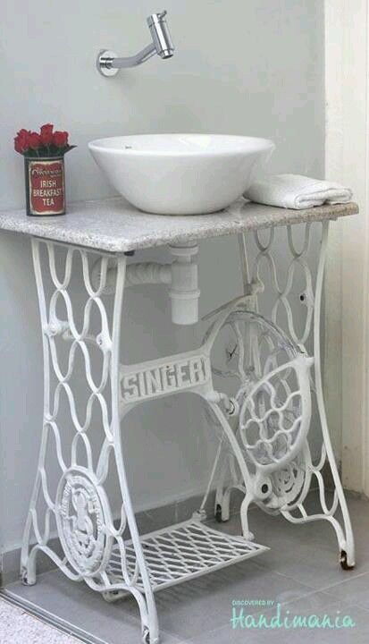 Way cool! The old Singer sewing machine table is perfect for the customer bathroom