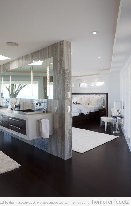 Elegant yet streamlined master bathroom. A wall hung vanity always helps create an illusion of space