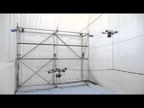 Watch two drones build a bridge strong enough for humans | The Verge