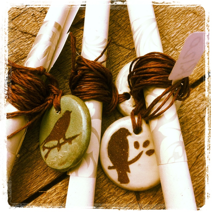 ceramic pendants with a scrolled message - clay art by Sonja Moore