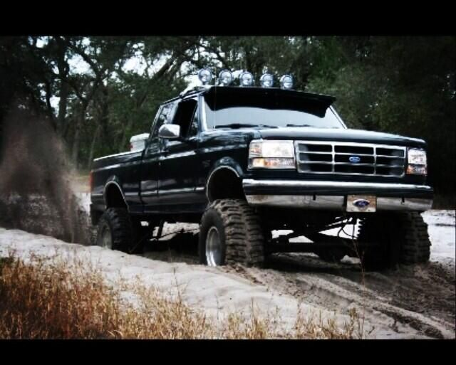"""lifted black Ford truck """"Mudder """" Mud truck"""