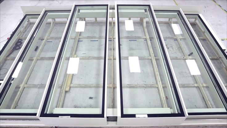 Bespoke designed sliding stacking rooflight by Glazing Vision. This rooflight is split into six sections, four of which slide in opposing directions and stack on fixed end sections