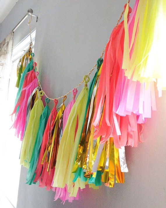 tissue tassel garland in coral, teal, neon lime, neon pink, and silver/gold mylar.