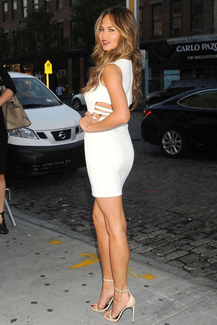 Chrissy Tiegen In A Short White Dress Showing Her Nice