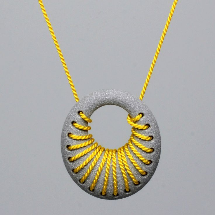 Featured at SXSW 2013: 3D Printed aluminum loop pendant with silk cord woven int...