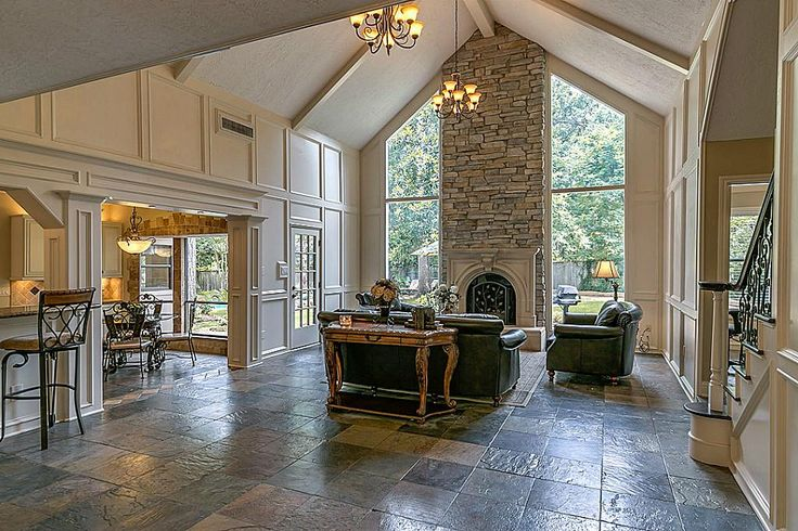 The grandness of the stack stone cathedral fireplace is captured as you enter this custom Great