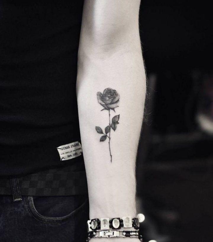 Fine line rose tattoo on the left inner forearm. Tattoo Artist: Drag