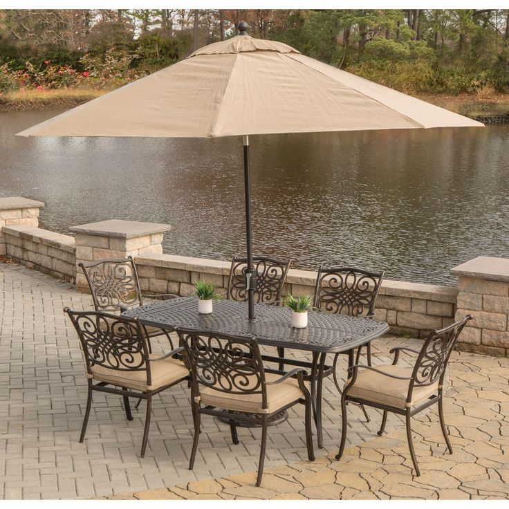 Hanover Traditions 7-Piece Dining Set in Tan with Cast-Top Dining Table, 9 Ft. Table Umbrella, and Umbrella Stand (Tan), Size 7-Piece Sets, Patio Furniture (Aluminum)