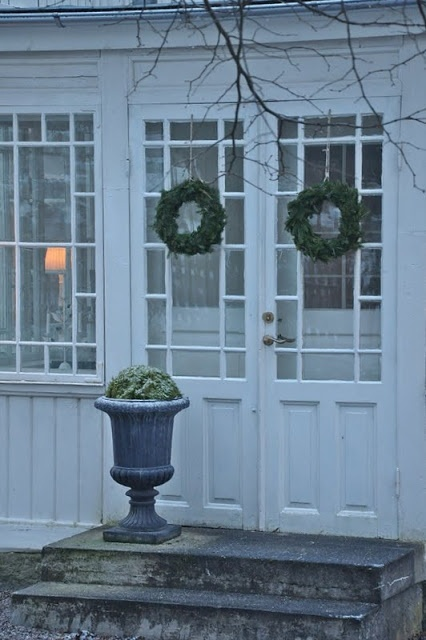 White Verandah. Keep the garlands and moss up for decor through the winter.