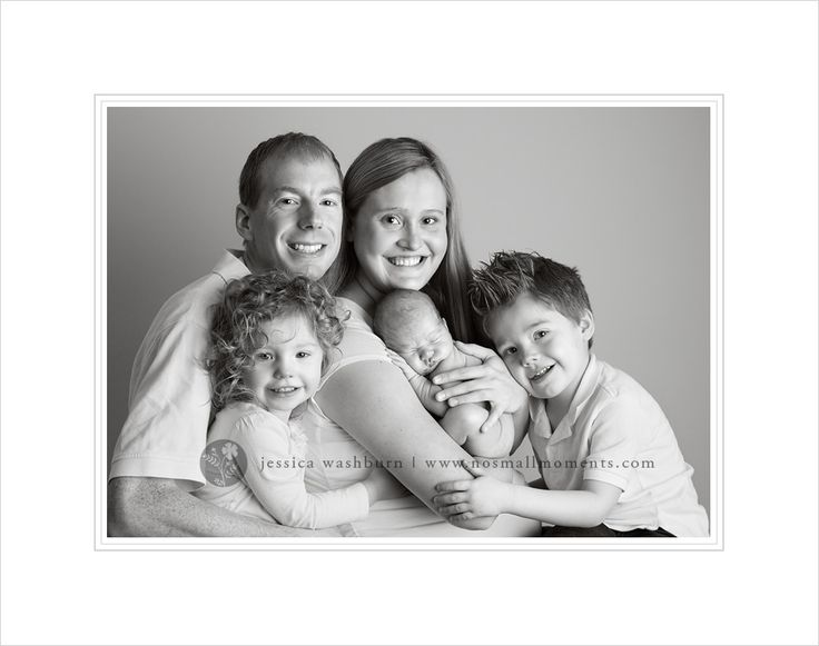 Family with newborn.  Copyright Jessica Washburn Photography