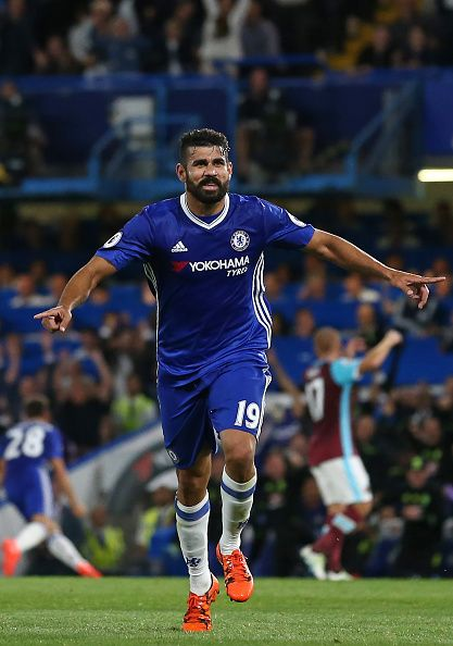 Chelsea's Brazilianborn Spanish striker Diego Costa celebrates after scoring…