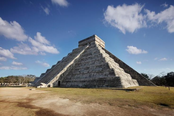 Spring Equinox at the main pyramid at Chichen Itza, Yucatan, Mexico. You can see the sunlight forming the snake on the left side of the pyramid of Kukulkan.