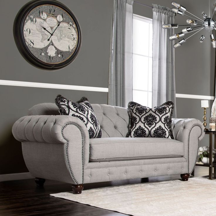 Inspired by victorian elegance, this loveseat offers a modern twist to the traditional chesterfield structure while keeping in line with royal appearances. The warm grey fabric wraps tightly around dacron-wrapped foam.