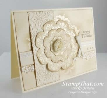 gorgeous all white handmade card ... lots of texture with embossing, real lace, layers , cloth flower .... medallion make with Daydream Medallions ... die cut with Floral Framelits ... a bit or edge sponging in Crumb Cake gives with vanilla card stock an aged elegant look ... stunning card ... Stampin' Up!