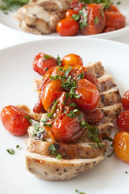 Easy Chicken Recipe with Garlic Balsamic Tomatoes! Make it all in one pan in 30 minutes or less. Just saute the chicken, then cook grape tomatoes with balsamic vinegar in the same pan until sweet and syrupy. You'll love this meal and add it to your rotation of quick chicken recipes!