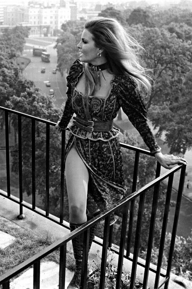 Up and away: Raquel Welch on a London balcony in 1970 even in her 70s, Racquel is hotter than ever! true definition of  a MILF