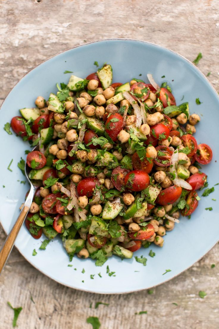 An easy, vegan summer cucumber salad that has chickpeas lightly fried with sumac and lemon then tossed with tomatoes, cucumbers, and cilantro.