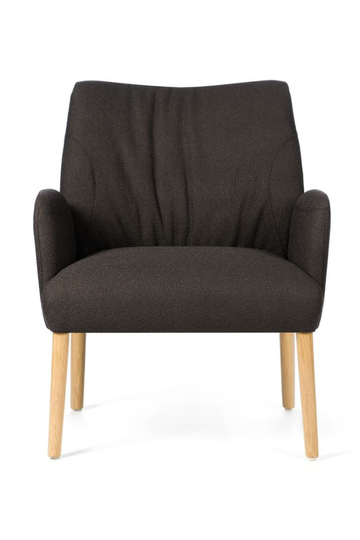 Comfortable arm chairs - This Upholstered Armchair Doesn T Only Seem Comfortable Take A Seat Armchairschairs