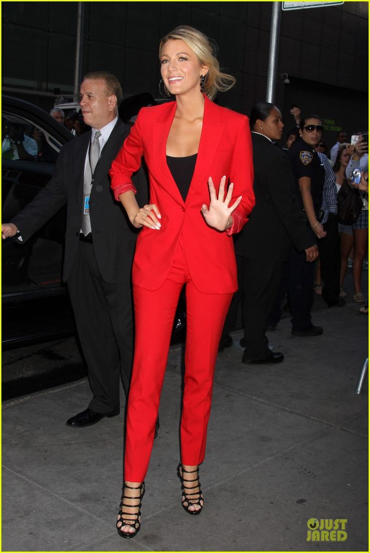 Blake Lively. Red suit and sexy, strappy black heels...new meaning to the phrase 'power suit'