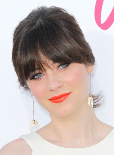 Zooey Deschanel's Chic, Brunette, Ponytail Hairstyle with Bangs