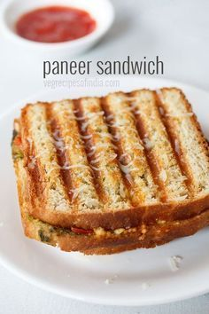 paneer sandwich recipe with step by step photos - simple and easy breakfast or snack idea of grilled paneer sandwich. the recipe shared is an indian style paneer sandwich which includes green chutney, spices and herbs.