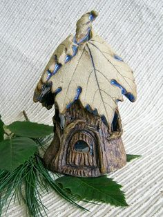 Little pottery house! Leave imprints on roof, this is so cute.