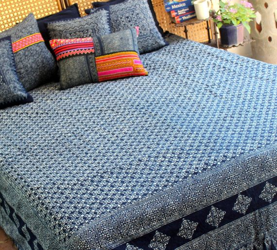 Snuggle up in beautiful comfort with this soft, 100% cotton Hmong indigo batik duvet cover. Using hand stamped batik by the talented Hmong women we have created a beautiful queen size duvet cover. Bohemian bedding for your one of a kind style. The duvet cover is backed with natural indigo blue cotton with ties to hold your duvet insert in place in the pocket.  Free worldwide shipping  Hmong indigo batik on cotton Blue 100% natural cotton backing Hand stamped intricate batik Button and loop…