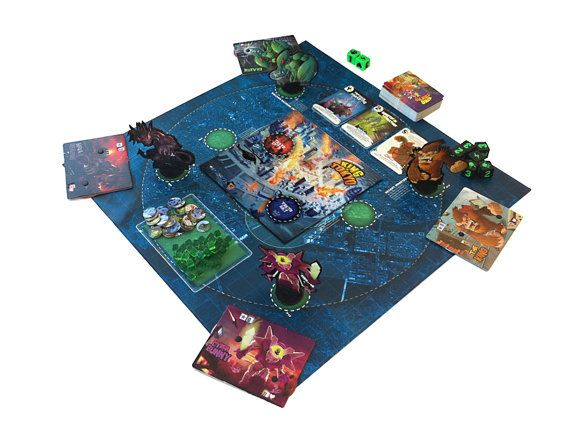 Enhanced play mat design for use with the King Of Tokyo board game