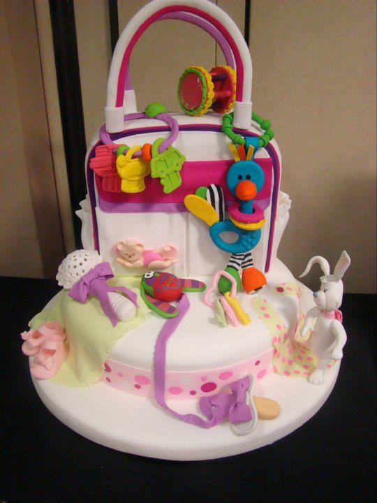 """Babyshower themed cake with fondant baby toys confetti lining the bottom of the cake with """"bundles of joy"""" written on it  shower baby baptism"""