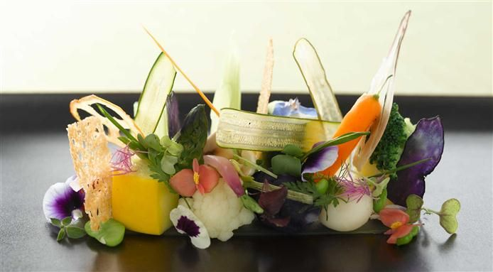 An healthy salad recipe shared by Andrea Aprea, chef at Vun - Park Hyatt restaurant in Milan, made with all the best summer vegetables and edible flowers