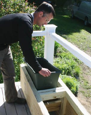 Professional Deck Builder: Easy Planter Boxes- use office garbage containers
