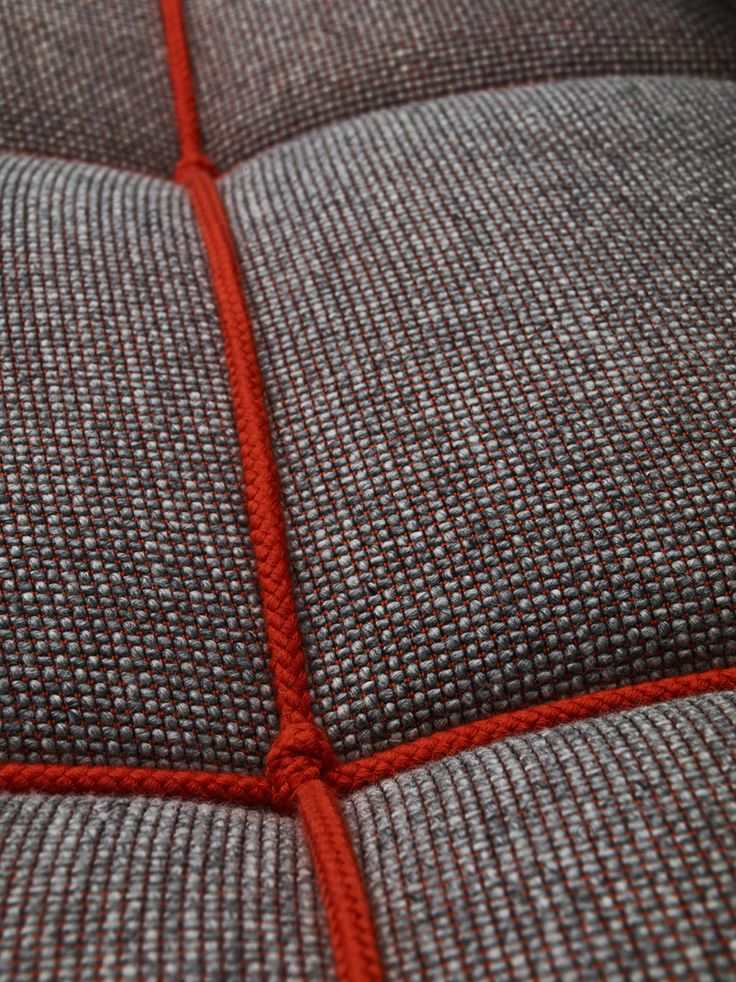 """""""I'm knots"""".  With the classic chesterfield sofa in mind, RUM.station has designed a new welcoming and voluminous sofa padded with a 100% new wool fabric from Camira Fabrics.   The shape of the sofa is made by tying a rope around it that matches the background color in the fabric.    """"I'm knots"""" comes in 8 different colors and starts out with a 3-seater."""
