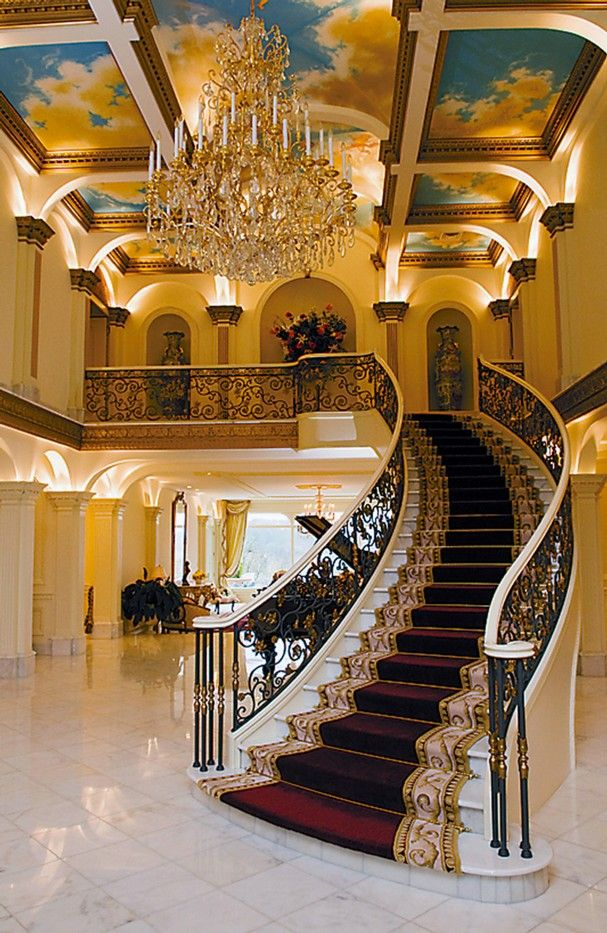 chandeliers and  grand stair case   | foyer featuring a grand staircase, a Swarovski crystal chandelier ...