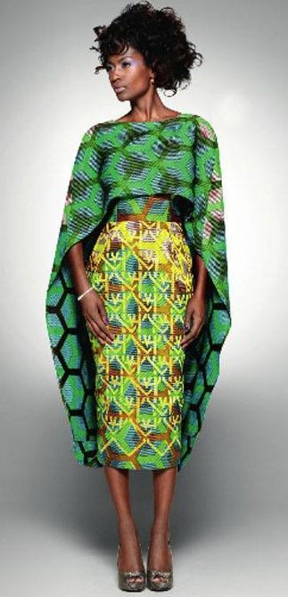 "The ""elegance"" of this dress and the ""confidence"" of this model makes everything about this picture look ""spectacular"".  Vlisco dress- African print"