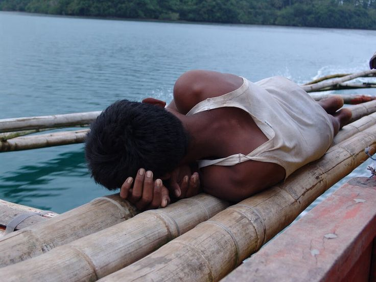 tired young boat driver, Philippines,2005