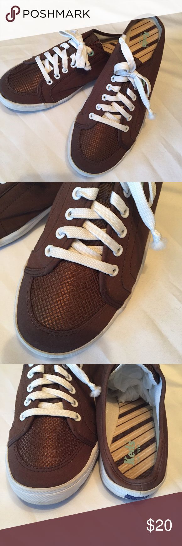 Keds slip on tennis shoes 10 Cute Keds brown slip on with small amount of teal details, size 10, great condition no stains or wear. Keds Shoes Mules & Clogs
