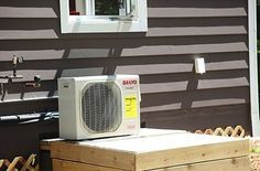 Small and efficient duct-less air conditioner was installed which is what I recommend for tiny houses as well instead of the window units because you can place this on the tongue of the trailer. They're more efficient and they look better.